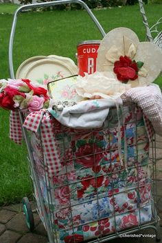Vintage cart with linens and vintage items.