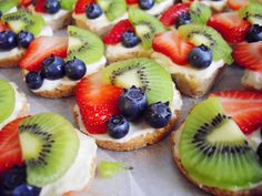 Mexican Wedding Fruit Pizza - This would be great for any party, I would maybe use sugar cookie dough for the cookie part.