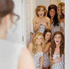 This is an interesting picture because instead of making the bride the main focus, the bridesmaids are the focus.  They are also located in the background, while the bride is blurred in the foreground.  This is a great example of a reaction and emotional response.