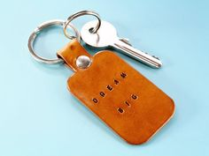 Inspirational Dream Big gift? This handmade Dream Big leather keyring would make an excellent leather gift for boyfriend. This leather keychain would also make an ideal best friend gift for a birthday. Also, handmade leather goods make great anniversary gifts for men and women. Check out my Etsy shop!! #keyring #keychain #anniversarygift #dreambig Leather Bookmark, Leather Keyring, Leather Gifts, Handmade Leather, Leather Anniversary Gift, Great Anniversary Gifts, Motivational Gifts, Inspirational Gifts, Gifts For Dad
