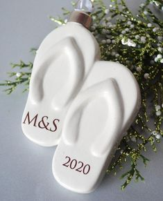 This fun flip flop ornament would make a lovely gift! Perfect for a  friend or family member who just got engaged, married, or celebrating a  special anniversary. The ornament is crafted, glazed fired and then  fired again. The ornament text is printed in deep brown/sepia color and  will include the couple's initials and year. #marriedornament #destinationwedding #tropicalwedding #beachwedding #weddinganniversary #sanniversarygift #couplesornament #anniversaryornament  #marriedgift…