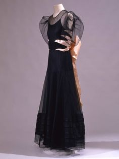 """Circa 1934 Long dress in """"point d'esprit"""" black tulle with tight black bustier; French."""