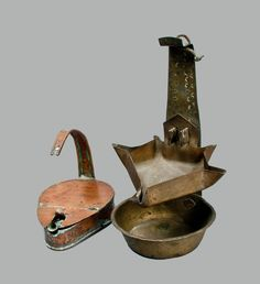 Two Metal Betty Lamps, 19th century
