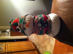 DIY-Snowman.  Old white socks, Christmas socks, rice, buttons, twine, glue gun and your good to go! My version of another pin! So much fun to make.