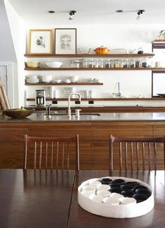 midcentury teak kitchen with a modern twist... so original, I've never seen a kitchen done with this type of wood
