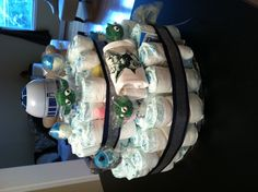 Star Wars diaper cake --complete with a yoda onesie and R2D2 piggy bank ckarmarkar81@gmail.com for info