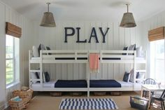 Two Ikea bunk beds painted white and and placed end-to-end.  Sleeps four for very little floor space.---great for older boys playroom--love by heidi