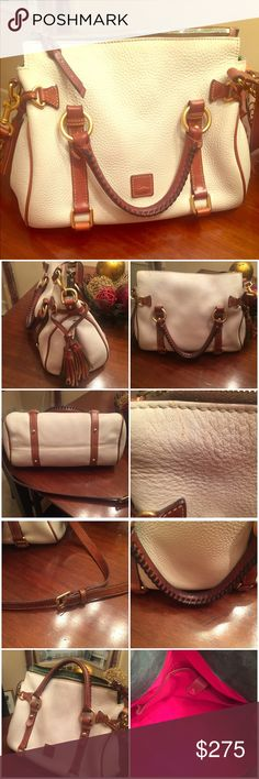 🎉🎉24 HOUR SALE 🎉🎉Dooney & Bourke Satchel Tomorrow at 11:30 PM EST the price goes back to $190. Florentine supple leather has the feel of fine saddlery. This chic satchel features timeless style with several carrying options. Two inside pockets and one zipper pockets. Cell phone pocket and inside key holder. Handle drop length 4.5 inches. Zipper closure. The bag looks brand new except for 2 flaws shown in photos. A tiny mark on the outside right by the zipper and some black dots on the…