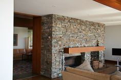 Eco Outdoor Bager dry stone walling on traditional indoor wood fireplace. Eco Outdoor | Badger dry stone walling | livelifeoutdoors | Outdoor fireplaces | Natural stone walling | Outdoor fireplace designs | Garden Ideas | Modern fireplaces | Outdoor patio fireplaces | Stone fireplaces | Feature tiles | Outdoor firepit | Natural + Organic