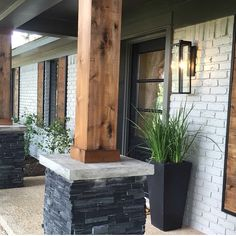 Joanna Gaines home. Gotta get me some wood pillars!
