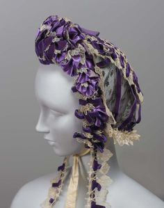 A lady's dress cap with black lace foundation trimmed elaborately with pleated purple satin ribbon, white machine made lace, narrow purple velvet ribbon loops and purp … Victorian Hats, Victorian Fashion, Vintage Fashion, Vintage Couture, Purple Satin, Purple Velvet, Purple Ribbon, Purple Dress, Civil War Dress