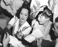 Merle Obregon And Hedda Hopper Sign Autographs At The Hollywood Canteen