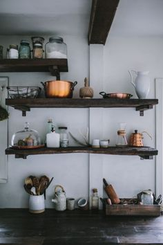 I love the use of copper on the rustic wooden shelves