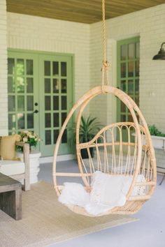 Rustic Modern Backyard Patio Design with boho hanging rattan chair and sage green painted french doors Decor, Hanging Chair, Patio Wall, Hanging Rattan Chair, Sage Green Paint, Patio Design, Modern Interior Design, Diy Decor, Boho Patio