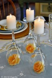 "Elegant little candle ""holders"" ...Clever, simple and pretttttttty cheap if you already have a nice set of wine glasses. Even if you don't, you can buy them for a buck at the Dollar Store."