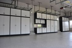 The floor is finished with a Floortex coating in Sedona. Large lockers and uppers with stainless steel pulls provide plenty of storage space (GL Custom Steel cabinetry). Overhead racks and slatwalls provide additional storage space. The entire garage was also painted.