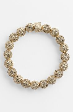 Making winter shiny with this gold studded ball bracelet.