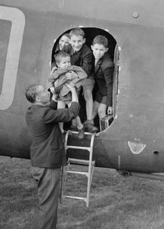 RAF Stirlings were used to relieve some of the suffering of the war. As well as returning Czechoslovaks to their own country, the Stirlings also returned to Britain with hundreds of Czechoslovak children, orphans who had been in concentration camps during the German occupation and who were being brought to England for rehabilitation. This image shows a Stirling returning to the RAF station at Crosby-on-Eden, Carlisle, with children being lifted out of the aircraft.