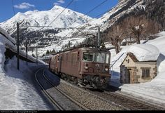 Re 4/4 (Re 425) # 172 and 171 of the BLS with the freight 49005 from Emmenbrücke to Lecco Maggia (Italy) are passing a typical old Gotthard ...