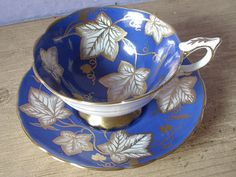 Vintage Royal Stafford bone china tea cup and saucer, blue tea cup set, English tea set, blue white gold leaves cup This is the wide rim tea cup Tea Cup Set, My Cup Of Tea, Tea Cup Saucer, Yellow Tea Cups, English Tea Cups, Teapots And Cups, Teacups, Royal Stafford, China Tea Sets