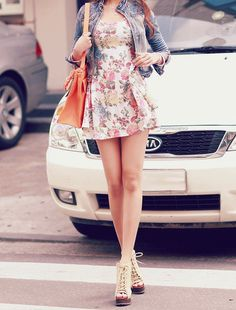 floral dress with faded denim jacket and lace up heels.
