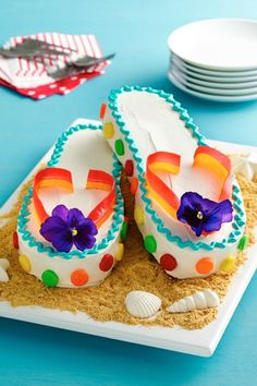 This fashionable and fun cake will make the little ones feel like they?re relaxing right on the beach! Fruit by the Foot and chewy fruit candies add bright pops of color Unique Cakes, Creative Cakes, Fancy Cakes, Cute Cakes, Flip Flop Cakes, Flip Flops, Beautiful Cakes, Amazing Cakes, Beautiful Birthday Cakes