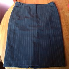 """Pinstripe Pencil Skirt Office chic.  Grey/Gray pin stripe. Fully lined. Front zipper and clip closure waist. Decorative buttons and short pockets on each side of  waist. Waist measurement side to side is approx 15"""" and waist to hem is approx 24"""". Back kick pleat. Please ask if you have questions. Norma Kamali Skirts Pencil"""