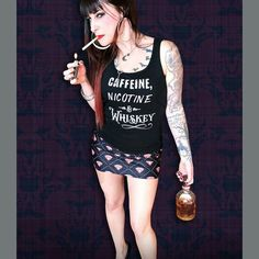 Badass Dark Justice aka The Hell Betty Barber modeling a new shirt and skirt available now at http://ift.tt/2q0UwJB #whiskey #cute #ruby #badass #nicotine #caffeine #punkrock