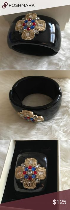 St.John black enamel cuff bracelet St. John black enamel cuff bracelet with signature gold tone design , and with blue red and clear Austrian crystals. Like new , in excellent condition . St. John Jewelry Bracelets
