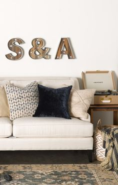 Sparkly marquee letters add a sweet, personalized touch to any comfy-cozy abode.