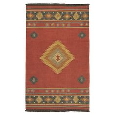 Bring Southwestern-inspired style home with this flatweave wool rug, artfully handcrafted in India.     Product: Rug...