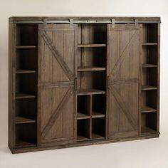 Wood Farmhouse Barn Door Bookcase from World Market. inner space measures 49.5''. Could make a great TV cabinet...