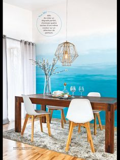 Teal dining room chairs and gold light fixture colorful and