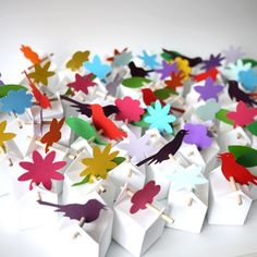 Paper favours could decorate tables or be handed out as people leave.