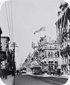 June 22, 1897: King St. W., looking east from west of Yonge St., buildings decorated for the Diamond Jubilee of Queen Victoria. Photographer unknown. - Courtesy Toronto Public Library.