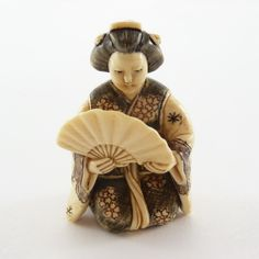 Woman with fan Netsuke - beautiful little sculptures but a pity they were carved from ivory, fortunately illegal now. Used on traditional Japanese dress with cords through...
