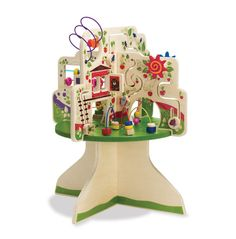 This wooden activity center is packed full of exciting features! Includes 4 quadrants with a variety of activities:  6 tracks with animal-themed gliders, 6 bead runs with colorful wooden beads, a spring flower and more. Adult assembly required.  Watch a clip courtesy of ABC's The View -  Best of the Toy Fair feature!