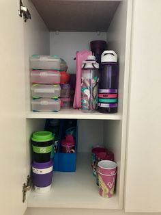 Top shelf: kids school lunch Box's, containers, food thermos and drink bottles Bottom shelf: spare drink bottles, travel mugs and spare kids cups.
