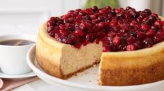 Why not add some spice to your menu with this Cranberry-Glazed Cinnamon Cheesecake? #dessert #recipe