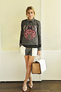 wearing an AnhHa sweater layered over a Paige Denim button down with Tibi shorts, Valentino rockstud flats and an Anya Hindmarch Bruton Tote.