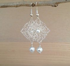 Items similar to Lace wire crochet earrings.Silver or Gold wire earrings. on Etsy, Diy Abschnitt, Wire Jewelry Earrings, Tatting Jewelry, Pearl Drop Earrings, Wire Wrapped Jewelry, Beaded Jewelry, Earrings Handmade, Handmade Jewelry, Bridal Earrings, Jewellery