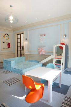 Suzie: Lily Z Design - Fun boy's playroom with Panton Junior Chairs in Tangerine & Light Blue, ...