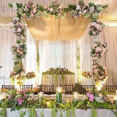 From Wedluxe magazine. Gorgeous floral over sweetheart table.