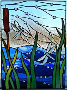Dragonfly Marsh - Stained glass panel made using copper foil method. For the sky I used taffeta glass and love the effect of movement that it creates. This panel measures 21 inches tall by 16 inches wide.
