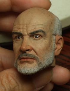 Repainted Medicom Henry Jones head.  Amazing how the paint job can make or break a sculpt.  That head sucks in my opinion but with this paint job it looks amazing.