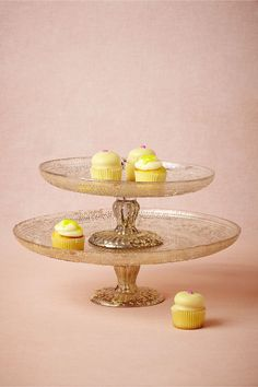 Antiquitarian Cake Stand from @BHLDN THESE can be hacked as well with candle holders, permabond, and whatever plates you like! I can make you these VERY easily! And they can stack if you decide to do cupcakes!