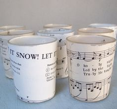 upcycle  glass candle holders and music sheets - 3 coats of varnish over the paper on exterior, add a tealight....................... and-voilà!