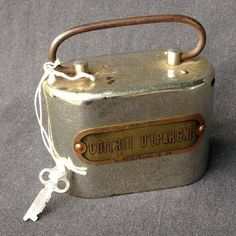 This heavy antique French safe deposit metal moneybox is a fabulous find to use and display on a desk :-) The small thing has that perfect retro industrial look and comes with original key. Meas. approx. 110x60mm at base and about 75mm tall (plus handle). Quite strong and heavy