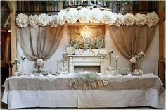 Another cute backdrop for a sweetheart table or wedding party table for a rustic wedding. Burlap Backdrop, Burlap Drapes, Burlap Chair Sashes, Burlap Tablecloth, Rustic Head Tables, Deco Champetre, Window Treatments Living Room, Inexpensive Wedding Venues, Sweetheart Table