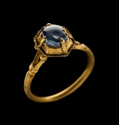 """""""Pie-dish"""" Bezel Sapphire Ring, 14th century, gold, sapphire, This ring would have been prized by its owner not only for the beauty and rarity of the sapphire but also for the talismanic quantities of that stone. This type of setting enclosing the stone in a box resembling a dish for baking pies in the oven and known as 'pie dish', was used in the 13th and 14th centuries."""